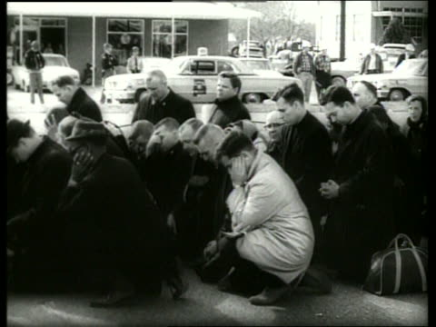 s crowd kneeling in prayer in civil rights march / selma, alabama / sound - social movement stock videos & royalty-free footage