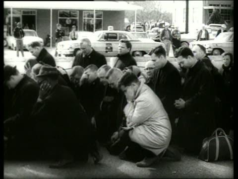 B/W 1960's crowd kneeling in prayer in civil rights march / Selma Alabama / SOUND