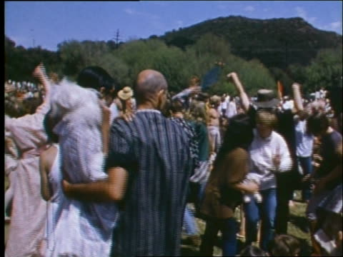 vídeos de stock e filmes b-roll de 1960's crowd of hippies dancing at outdoor concert - love in