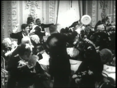 b/w 1930's crowd of people throwing pies at reception / keystone hotel - slapstick stock videos & royalty-free footage
