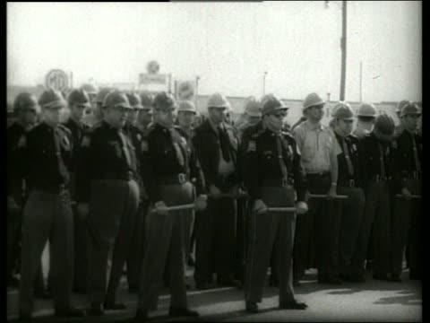 b/w 1960's crowd of policemen holding nightsticks / selma alabama / sound - selma alabama stock videos & royalty-free footage