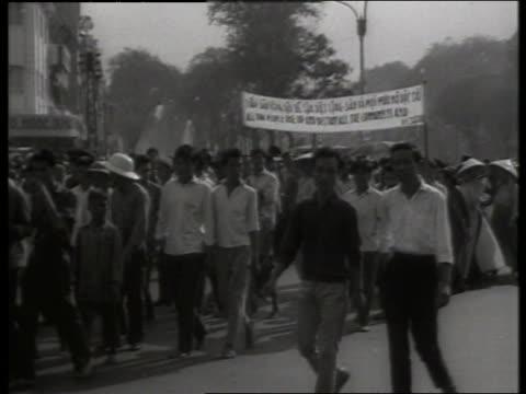 B/W 1960's crowd of Vietnamese demonstrating in street / Saigon / SOUND