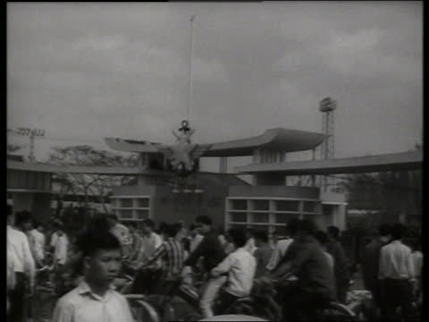 b/w 1960's crowd of vietnamese in front of military base / sound - vietnamese military stock videos & royalty-free footage