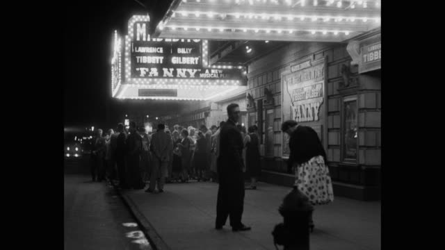 vidéos et rushes de 1950's - crowd standing outside majestic theater showing 'fanny' at night, manhattan, new york city, new york state, usa - théâtre