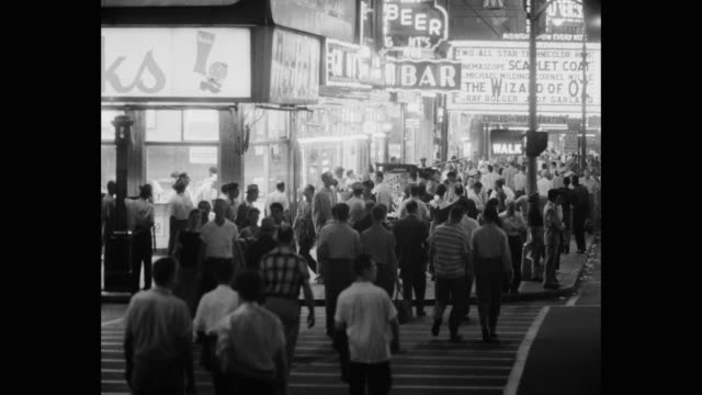 1950's - crowded times square at night, new york city, new york state, usa - zebra crossing stock videos & royalty-free footage