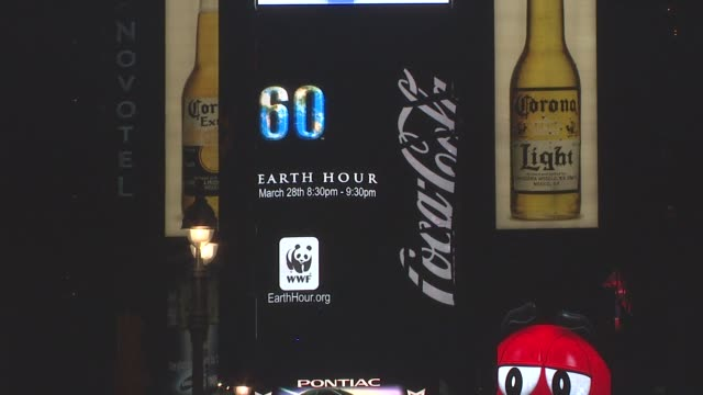 wwf's earth hour 2009 coca cola signage at the wwf's earth hour 2009 at new york ny - earth hour stock videos & royalty-free footage
