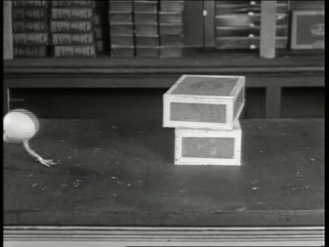 stockvideo's en b-roll-footage met b/w 1930's egg with webbed feet walking on counter past cigar boxes / unreal newsreel - zwemvlies