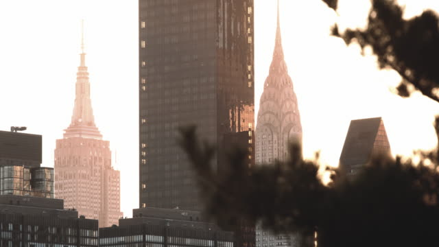 nyc's empire state building and chrysler building at sunset - 4k - chrysler building stock videos & royalty-free footage