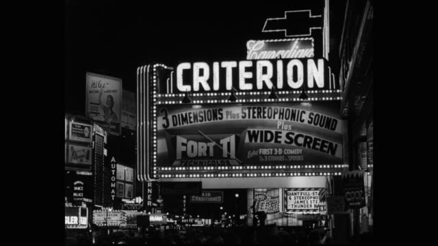 1950's exterior shot of criterion theater marquee at times square at night, manhattan, new york city, new york state, usa - theater marquee commercial sign stock videos & royalty-free footage