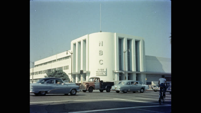 1950's exterior view of nbc building with traffic on street, los angeles, california, usa - nbc stock videos & royalty-free footage