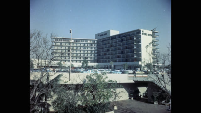 1950's exterior view of the beverly hilton hotel, los angeles, california, usa - the beverly hilton hotel stock videos & royalty-free footage