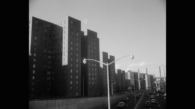 1950's - fdr drive next to the lillian wald houses, east village, new york city, new york state, usa - 公営アパート点の映像素材/bロール