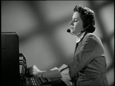 b/w 1950's female telephone operator connecting calls - switchboard operator stock videos & royalty-free footage