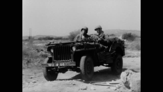 1940's film montage of us army soldiers driving jeep on dirt road - 4x4 stock videos & royalty-free footage