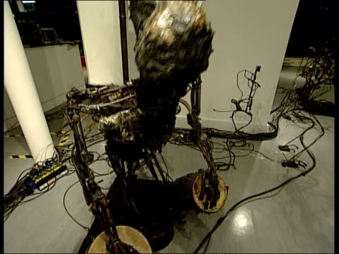 UK's first museum devoted to kinetic and electronic art opens in East London Robot sculpture hitting a set of bongo drums with drumsticks / Sculpture...