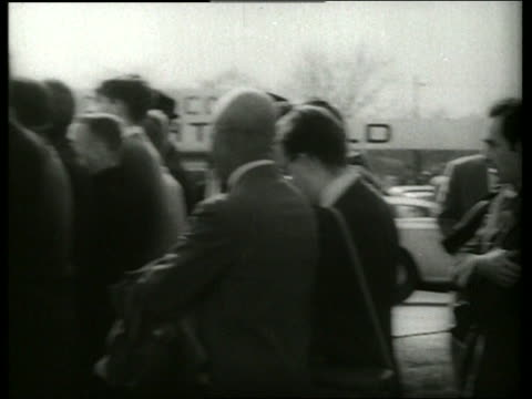 B/W 1960's PAN from crowd in civil rights march to police / Selma Alabama / SOUND