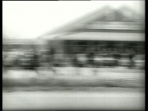 vídeos de stock, filmes e b-roll de b/w 1960's pan from police to civil rights march / selma alabama / sound - civil