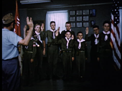 1950's group of boy scouts taking pledge with leader - boy scout stock videos & royalty-free footage