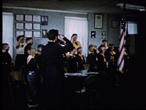 1950's group of cub scouts taking pledge with leaders - boy scout stock videos and b-roll footage