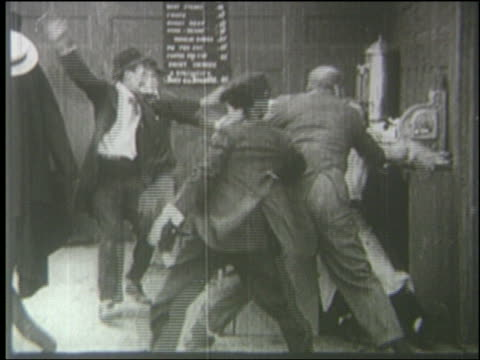 B/W 1910's group of men fighting in diner