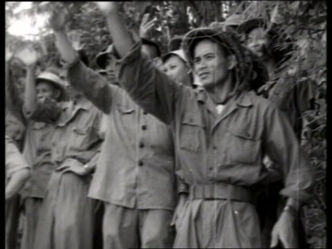 B/W 1970's group of Vietnamese soldiers waving / Vietnam / NO