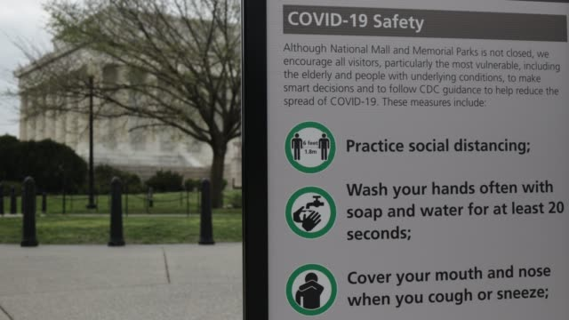 s guidelines on how to reduce the spread of covid-19 is posted near the lincoln memorial april 1, 2020 in washington, dc. the district of columbia... - maryland us state stock videos & royalty-free footage