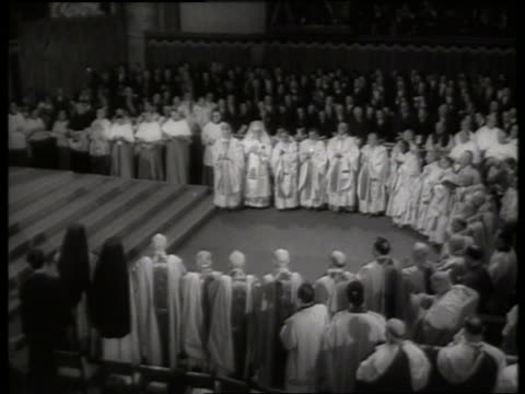 b/w 1960's high angle of crowd of clergy in st peter's basilica / rome - clergy stock videos & royalty-free footage
