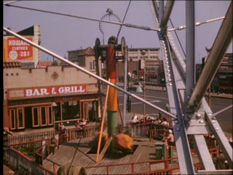 1940's high angle of looping swinging ride / coney island - coney island stock videos and b-roll footage