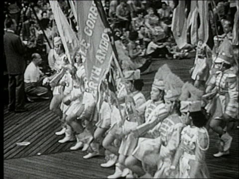 b/w 1940's high angle of majorettes passing camera in parade / atlantic city boardwalk - only teenage girls stock videos & royalty-free footage
