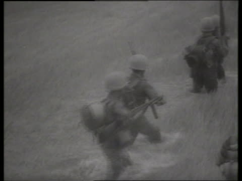 b/w 1960's high angle of soldiers walking thru rice paddy / vietnam / sound - m16 stock videos & royalty-free footage