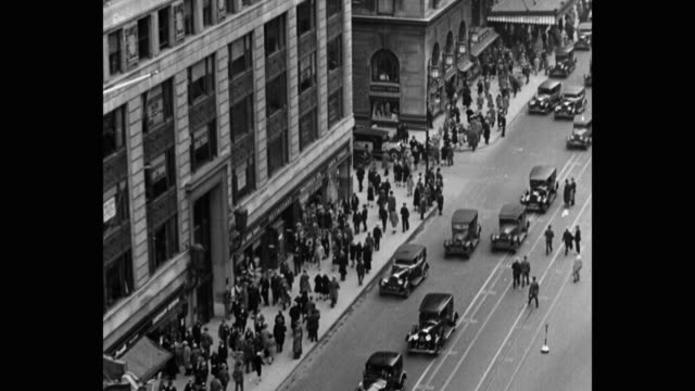 1930's - high angle view of busy street in city, chicago, illinois, usa - chicago illinois stock-videos und b-roll-filmmaterial