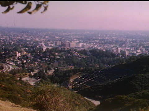 vidéos et rushes de 1940's high angle view of los angeles - hollywood californie