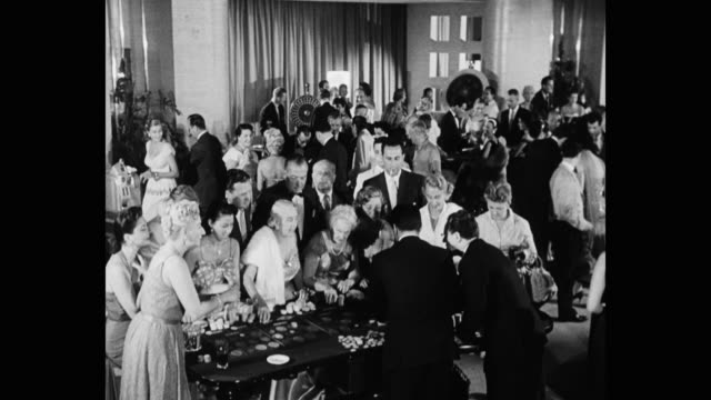 1950's - high angle view of people playing in casino - craps stock videos & royalty-free footage