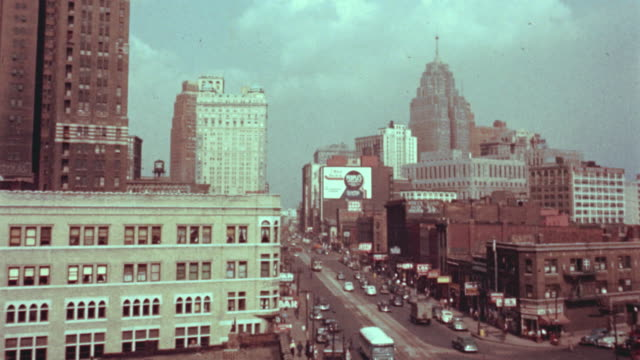 vidéos et rushes de 1940's high angle wide shot of buildings + traffic in detroit - michigan