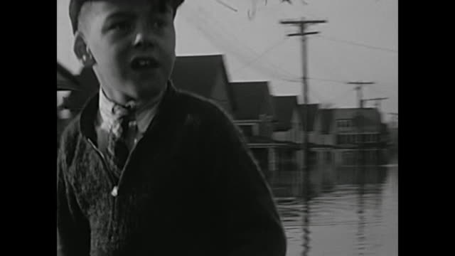 1930's home movie - men in small boats in flooded streets - town stock videos & royalty-free footage