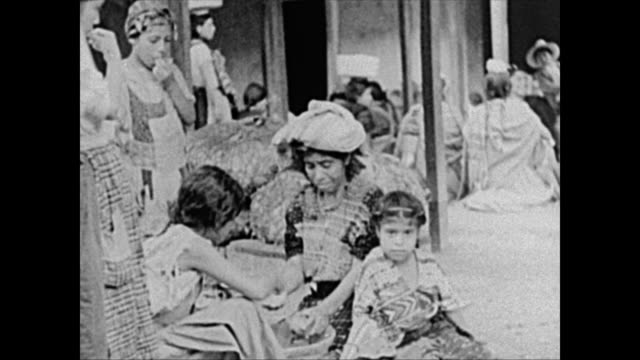 1940's indigenous people at street market in guatemala - mayan stock videos & royalty-free footage