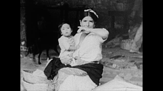 1940's indigenous woman with her son smiles for camera in guatemala - mayan stock videos & royalty-free footage