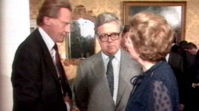 stockvideo's en b-roll-footage met 1980's int margaret thatcher stands talking with cabinet minister geoffrey howe mp and michael heseltine mp early 1990's ext michael heseltine along... - prime minister