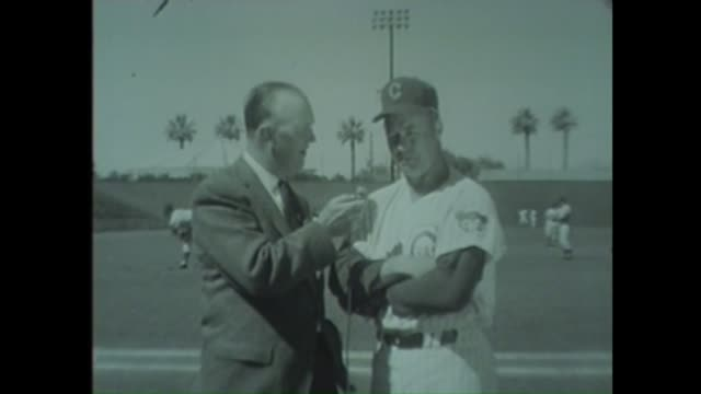 wgn's jack brickhouse interviews cubs manager bob kennedy during spring training at rendezvous park in mesa arizona in 1963 - spring training stock videos & royalty-free footage