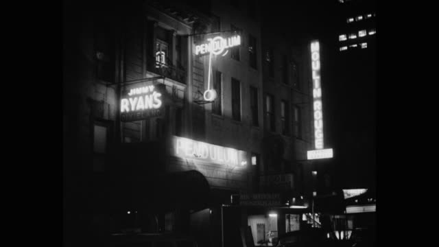 vidéos et rushes de 1950's - jimmy ryan's dixieland, pendulum bar, moulin rouge  exterior at night, new york city, new york state, usa - vie nocturne