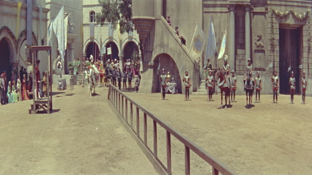 1500's knight in armor rides horse past camera in jousting tournament / diane (1956) - jousting stock videos and b-roll footage
