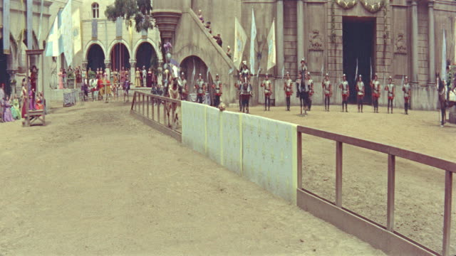 vidéos et rushes de 1500's knights in armor jousting on horses, 1 knight is knocked down / diane (1956) - reconstitution