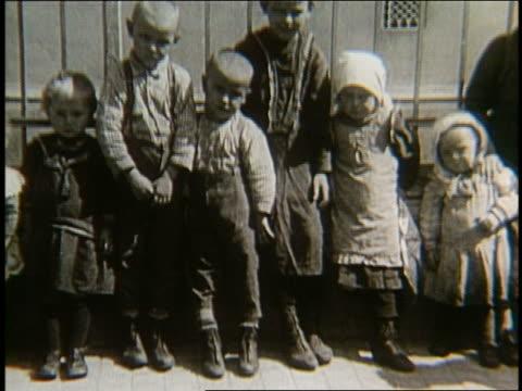 B/W 1900's line of immigrant children
