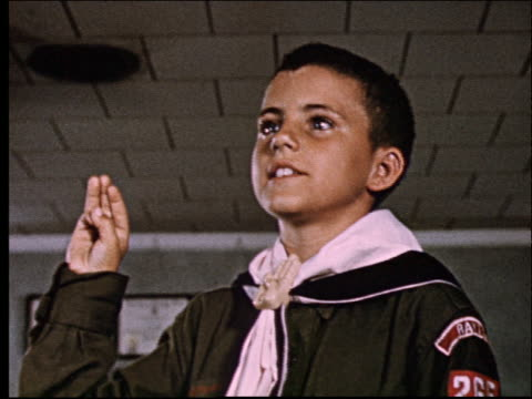 1950's low angle close up of boy in boy scout uniform saying pledge - boy scout stock videos and b-roll footage