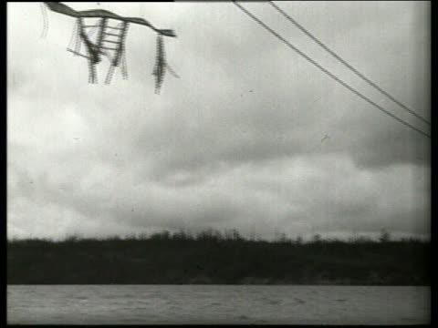B/W 1940's low angle PAN of destroyed bridge / Tacoma Narrows Bridge / SOUND