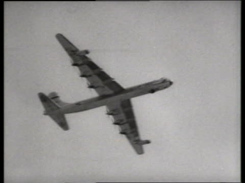 b/w 1950's low angle of military bomber flying over camera / lowry air force base, denver / sound - bomber plane stock videos and b-roll footage