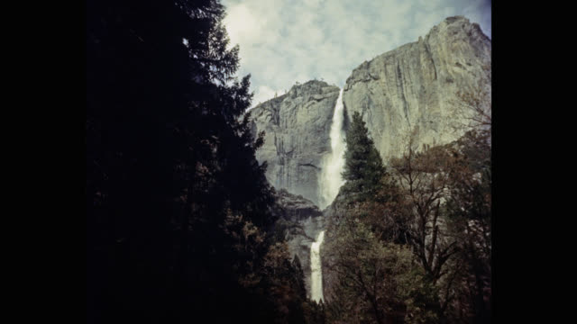 1950's low angle view of yosemite falls in yosemite national park, california, usa - natural parkland stock videos & royalty-free footage