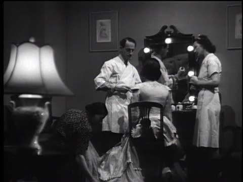 1930's - makeup applied to actress in dressing room - skådespelerska bildbanksvideor och videomaterial från bakom kulisserna