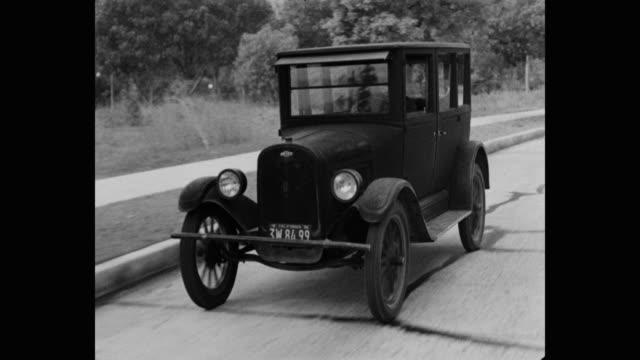 1950's -  man driving vintage chevrolet car on road in california - シボレー点の映像素材/bロール