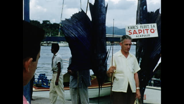 1950's Man poses for camera with Sailfish in Mexico HOME MOVIE